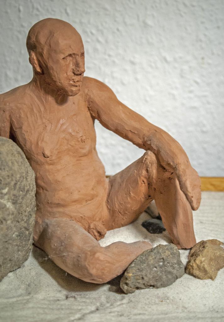 sitzender Mann